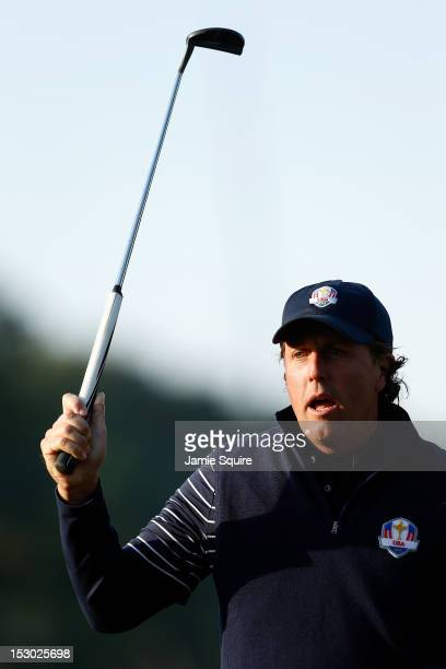 Phil Mickelson of the USA reacts to a missed putt on the fourth hole during day two of the Morning Foursome Matches for The 39th Ryder Cup at Medinah...