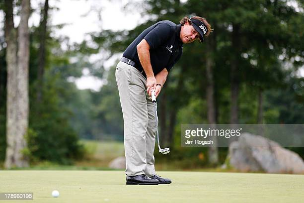 Phil Mickelson of the USA reacts to his putt on the 15th green during the second round of the Deutsche Bank Championship at TPC Boston on August 31,...