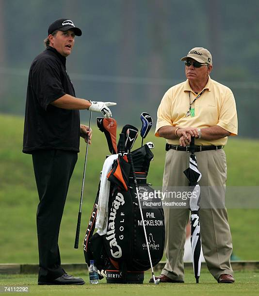 Phil Mickelson of the USA talks with his coach Butch Harmon during the practice round for THE PLAYERS Championship on The Stadium Course at the TPC...
