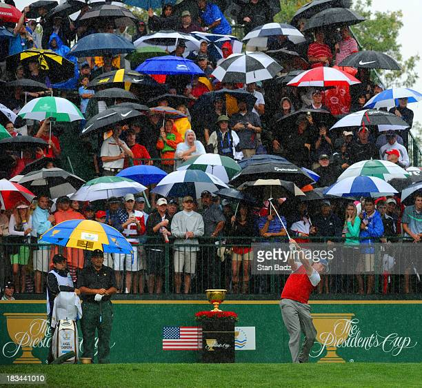 Phil Mickelson of the U.S.A. Team hits a tee shot in the rain on the first hole during the final round of The Presidents Cup at Muirfield Village...