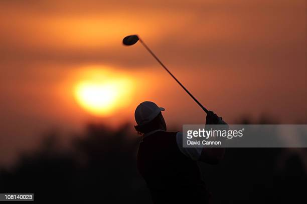 Phil Mickelson of the USA warming up on the driving range as the sun rises before the proam as a preview for the 2011 Abu Dhabi HSBC Golf...