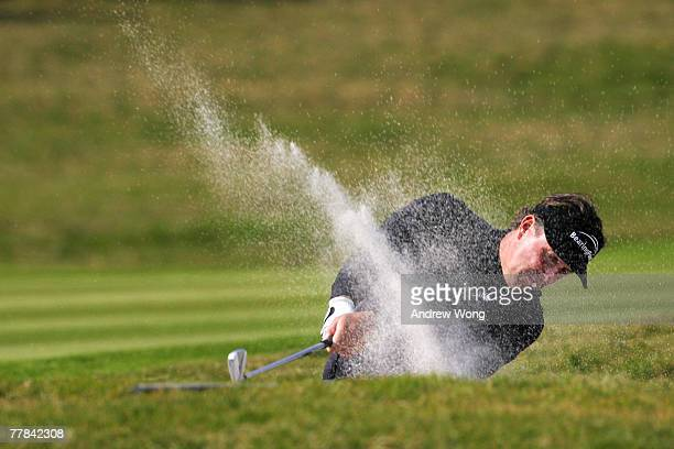 Phil Mickelson of USA plays a bunker shot on the 9th during the final day of the HSBC Champions at the Sheshan Golf Club on November 11, 2007 in...