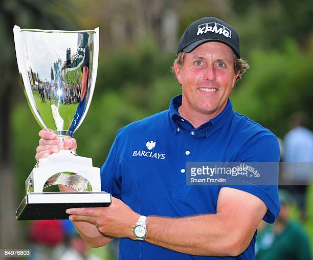 Phil Mickelson of USA with the trophy after winning the final round of the Northern Trust Open at the Riviera Country Club February 22 2009 in...