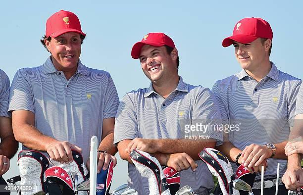 Phil Mickelson Patrick Reed and Jordan Spieth of the United States team pose with the team during a photocall on the practice ground prior to the...