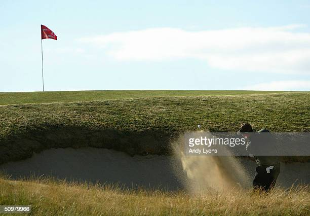 Phil Mickelson plays a bunker shot on the 11th hole during the final round of the 104th US Open at Shinnecock Hills Golf Club on June 20 2004 in...