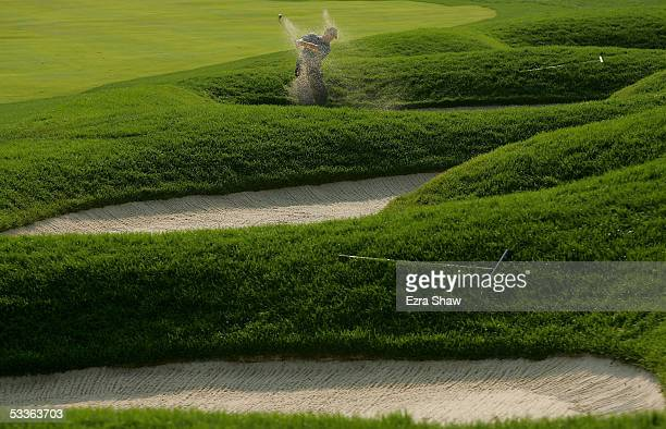 Phil Mickelson plays a bunker shot on the 13th hole during the second round of the 2005 PGA Championship at Baltusrol Golf Club on August 12, 2005 in...