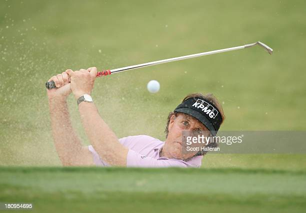 Phil Mickelson plays a shot during a practice round prior to the start of the TOUR Championship by CocaCola at East Lake Golf Club on September 18...