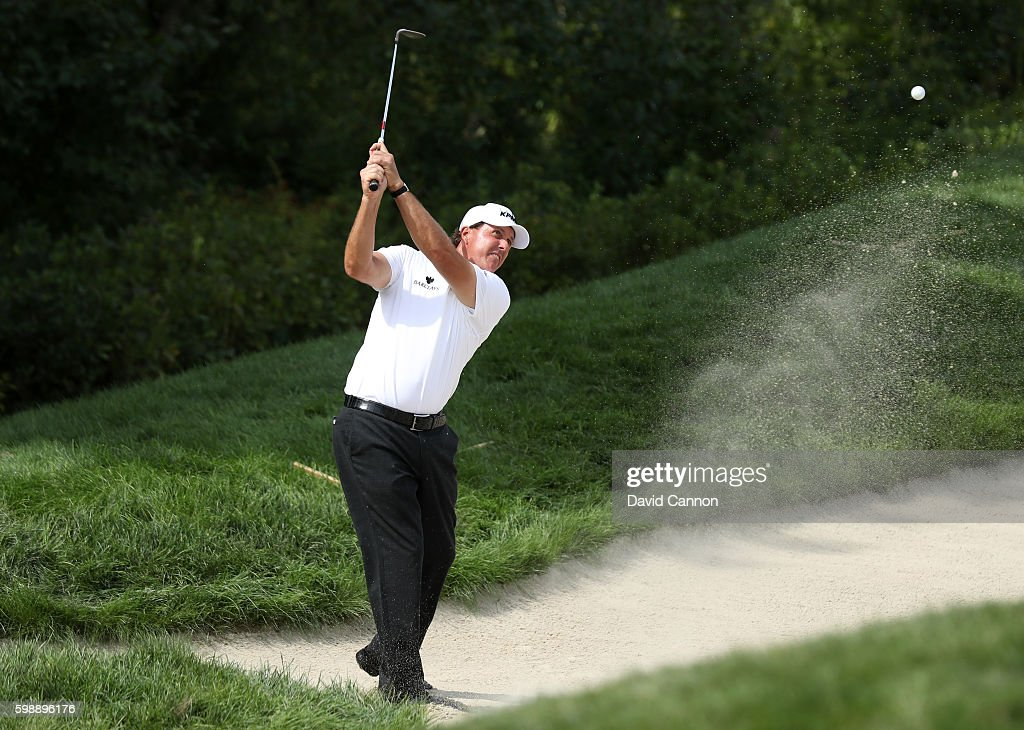 Phil Mickelson plays a shot from a bunker on the 18th hole during the second round of the Deutsche Bank Championship at TPC Boston on September 3, 2016 in Norton, Massachusetts.