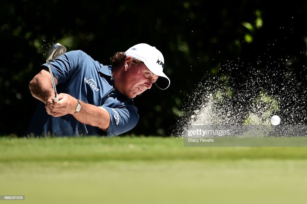 Phil Mickelson plays a shot from a bunker on the fifth hole during Round One of the DEAN & DELUCA Invitational at Colonial Country Club on May 25, 2017 in Fort Worth, Texas.