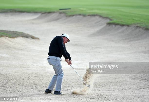 Phil Mickelson plays a shot out of the bunker during the second round of Valero Texas Open at TPC San Antonio Oaks Course on April 02, 2021 in San...