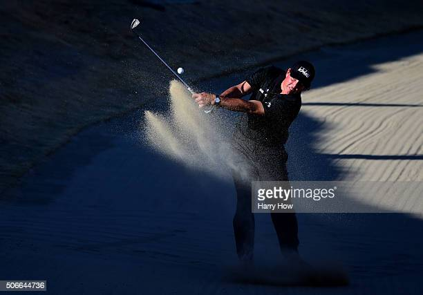 Phil Mickelson plays a shot out of the bunker on the 16th hole during the final round of the CareerBuilder Challenge In Partnership With The Clinton...