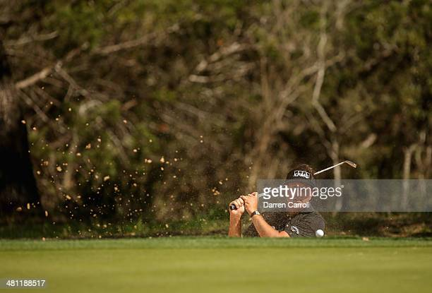 Phil Mickelson plays a shot out of the bunker on the 8th during Round Two of the Valero Texas Open at TPC San Antonio ATT Oak Course on March 28 2014...