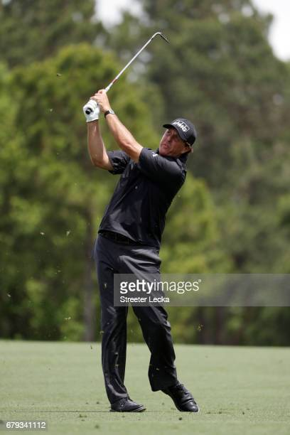 Phil Mickelson plays an approach shot on the third hole during round two of the Wells Fargo Championship at Eagle Point Golf Club on May 5 2017 in...