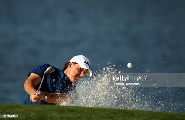 Phil Mickelson plays from a greenside bunker on the 14th during the second round of the Quail Hollow Championship at Quail Hollow Country Club on...
