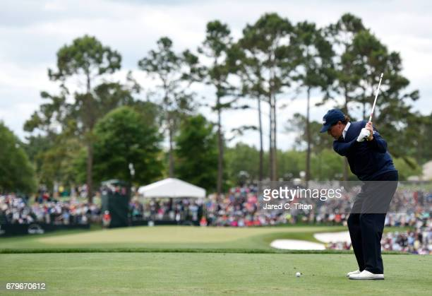 Phil Mickelson plays his shot from the fifth tee during round three of the Wells Fargo Championship at Eagle Point Golf Club on May 6 2017 in...