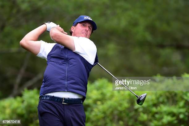 Phil Mickelson plays his shot from the fourth tee during round three of the Wells Fargo Championship at Eagle Point Golf Club on May 6, 2017 in...