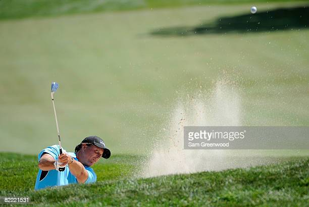 Phil Mickelson plays out of a bunker on the sixth hole during round two of the 90th PGA Championship at Oakland Hills Country Club on August 8 2008...