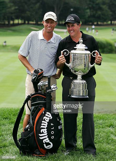Phil Mickelson poses with his caddie James MacKay and the Wanamaker Trophy after winning the 2005 PGA Championship with a 4under par 276 on August 15...