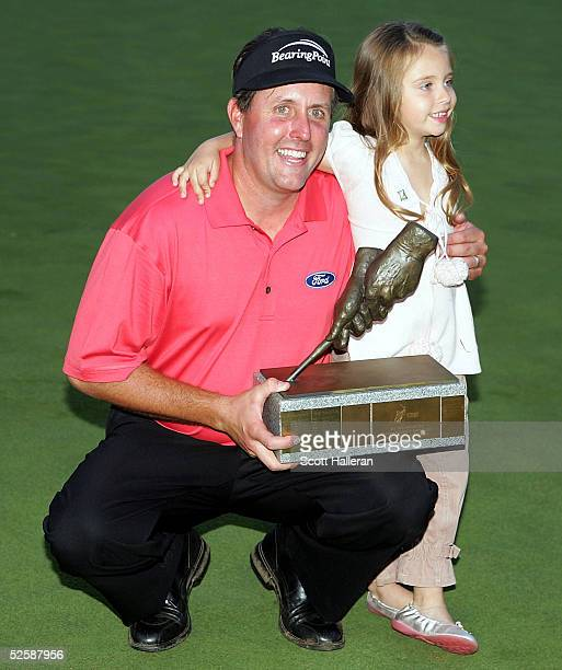 Phil Mickelson poses with his daughter Amanda and his trophy after defeating Rich Beem on the fourth playoff hole to win the Bellsouth Classic at the...