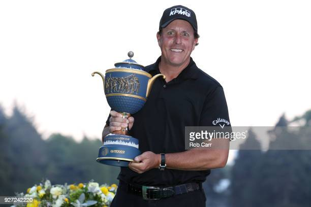 Phil Mickelson poses with the Gene Sarazen Cup after winning the World Golf ChampionshipsMexico Championship on a playoff hole at Club De Golf...