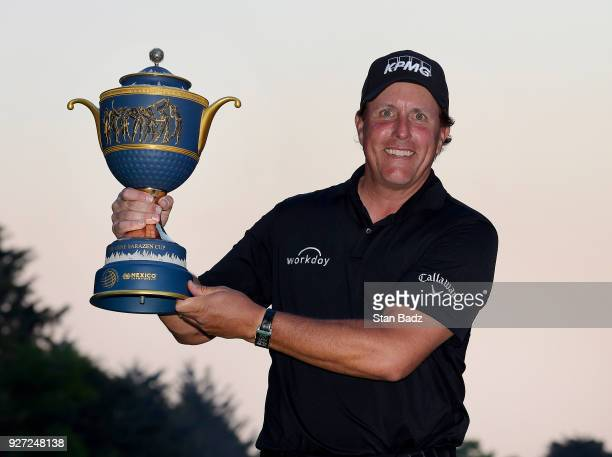 Phil Mickelson poses with the Gene Sarazen Cup after winning the World Golf Championships-Mexico Championship at Club de Golf Chapultepec on March 4,...