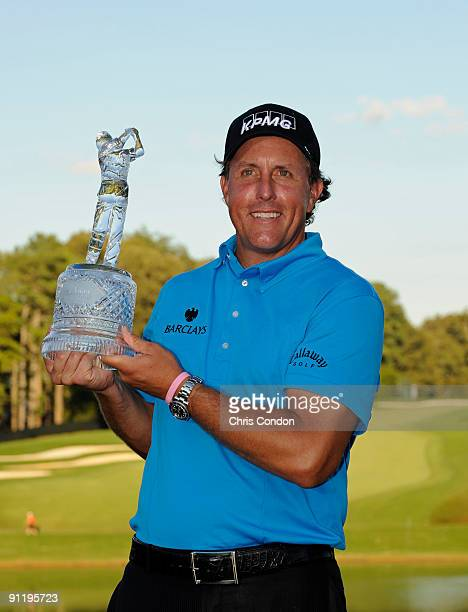 Phil Mickelson poses with the tournament trophy after winning THE TOUR Championship presented by CocaCola the final event of the PGA TOUR Playoffs...