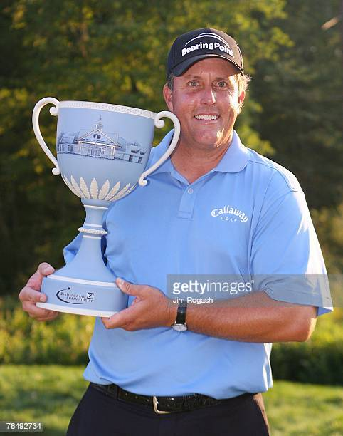 Phil Mickelson poses with the trophy after a two-stroke victory at the Deutsche Bank Championship, the second event of the new PGA TOUR Playoffs for...