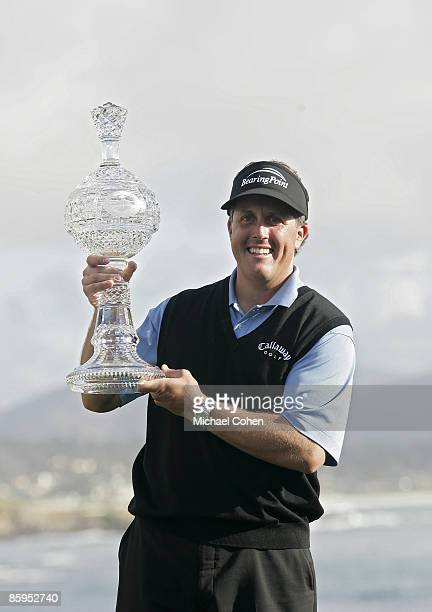Phil Mickelson poses with the trophy after winning the 2007 ATT Pebble Beach National ProAm on the Pebble Beach Golf Links in Pebble Beach California...