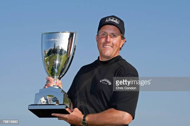Phil Mickelson poses with the trophy after winning the Northern Trust Open held on February 17, 2008 at Riviera Country Club in Pacific Palisades,...