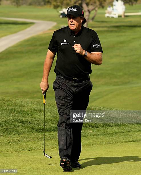 Phil Mickelson pumps his fist after making a birdie putt on the 14th hole at the North Course at Torrey Pines Golf Course during the second round of...