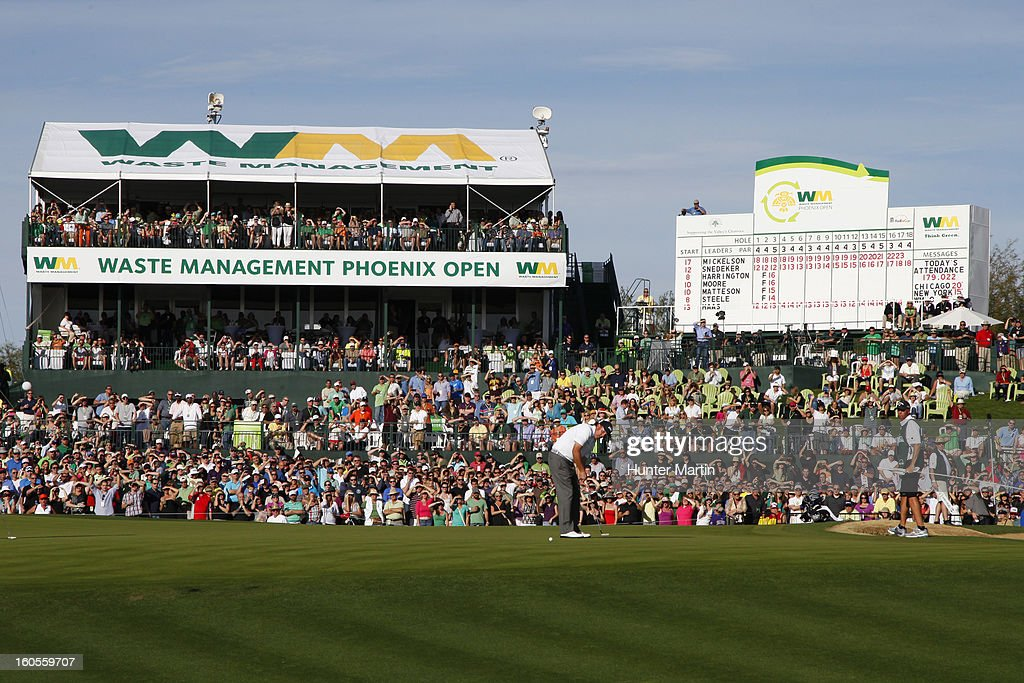 Phil Mickelson putts for birdie on the 18th hole during the third round of the Waste Management Phoenix Open at TPC Scottsdale on February 2, 2013 in Scottsdale, Arizona.