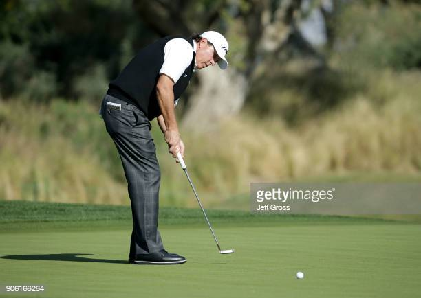 Phil Mickelson putts on the 18th green during practice for the CareerBuilder Challenge at the Jack Nicklaus Tournament Course at PGA West on January...