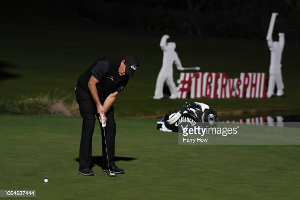 Phil Mickelson putts to defeat Tiger Woods during The Match Tiger vs Phil at Shadow Creek Golf Course on November 23 2018 in Las Vegas Nevada