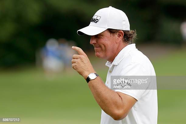 Phil Mickelson reacts after a birdie putt on the sixth green during the final round of the FedEx St Jude Classic at TPC Southwind on June 12 2016 in...