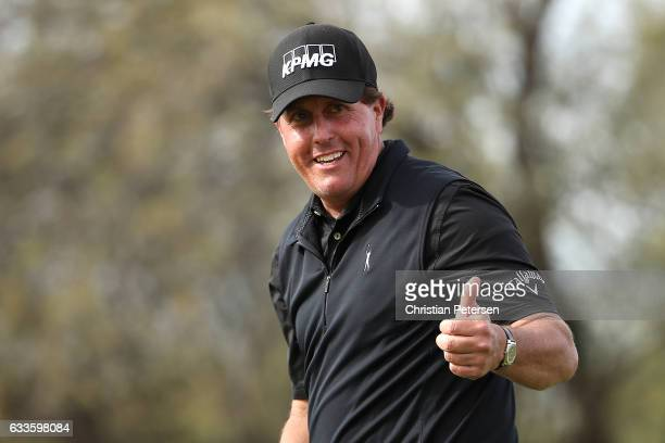 Phil Mickelson reacts after making his birdie putt on the ninth green during the first round of the Waste Management Phoenix Open at TPC Scottsdale...