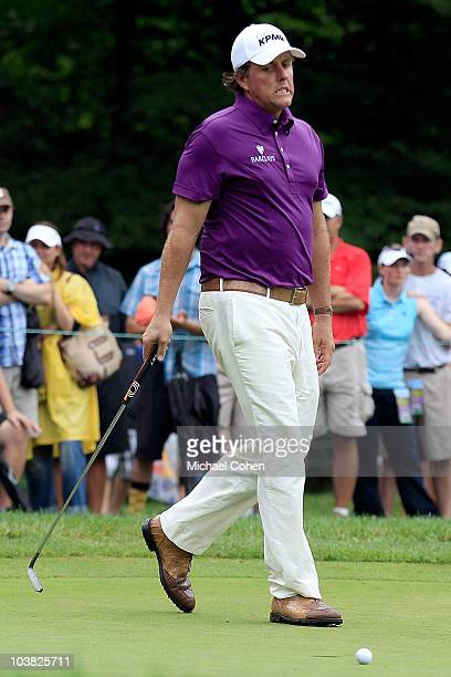 Phil Mickelson reacts after missing a birdie putt on the seventh green during the first round of the Deutsche Bank Championship at TPC Boston on...