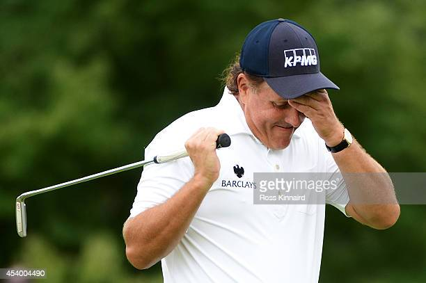 Phil Mickelson reacts after missing a putt for birdie on the 10th green during the third round of The Barclays at The Ridgewood Country Club on...