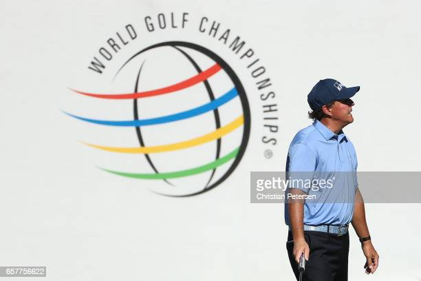 Phil Mickelson reacts after putting on the 16th hole of his match during round five of the World Golf ChampionshipsDell Technologies Match Play at...