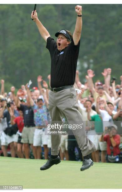 Phil Mickelson reacts after winning his first major championship with a birdie on the 18th hole at the Masters Tournament in Augusta Georgia on April...