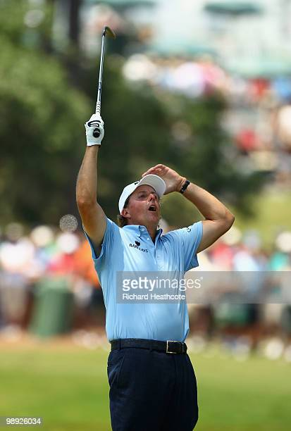 Phil Mickelson reacts as he nearly pitches in for eagle on the 16th hole during the third round of THE PLAYERS Championship held at THE PLAYERS...