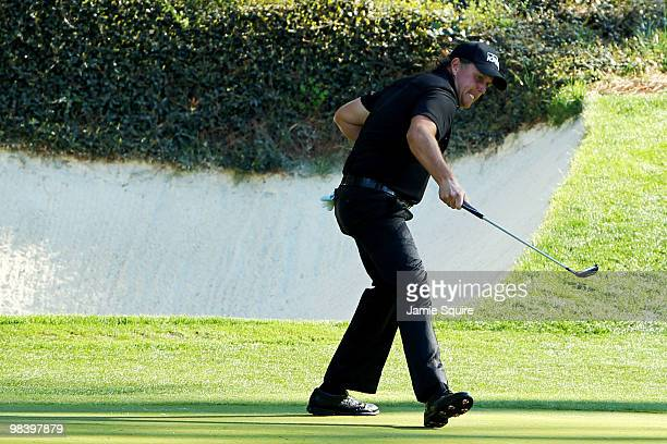 Phil Mickelson reacts to a birdie putt on the 12th green during the final round of the 2010 Masters Tournament at Augusta National Golf Club on April...