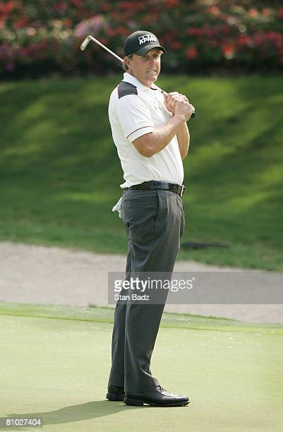 Phil Mickelson reacts to his missed putt at the 14th green during the first round of THE PLAYERS Championship on THE PLAYERS Stadium Course at TPC...