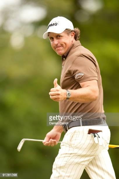 Phil Mickelson reacts to his putt during the continuation of the final round of the 109th US Open Championship on the Black Course at Bethpage State...