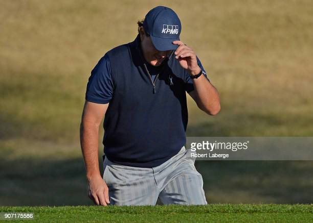 Phil Mickelson reacts to his shot out of the bunker on the 10th hole to make birdie during the second round of the CareerBuilder Challenge at the...