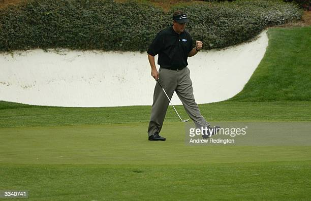 Phil Mickelson reacts to sinking a birdie putt on the 12th green during the final round of the Masters at the Augusta National Golf Club on April 11,...