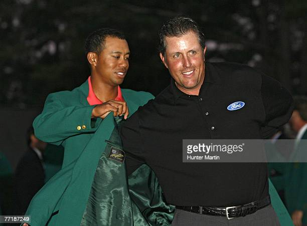 Phil Mickelson receives his green jacket from Tiger Woods after winning the 2006 Masters at the Augusta National Golf Club in Augusta Georgia on...