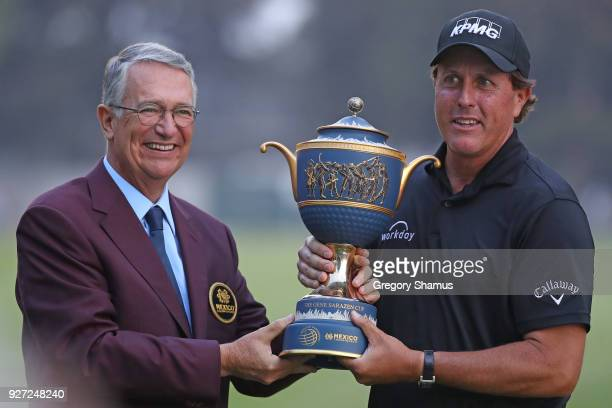 Phil Mickelson receives the Gene Sarazen Cup from Ricardo Salinas Pliego after winning the World Golf ChampionshipsMexico Championship on a playoff...