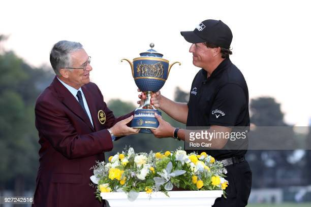 Phil Mickelson receives the the Gene Sarazen Cup after winning the World Golf ChampionshipsMexico Championship on a playoff hole at Club De Golf...
