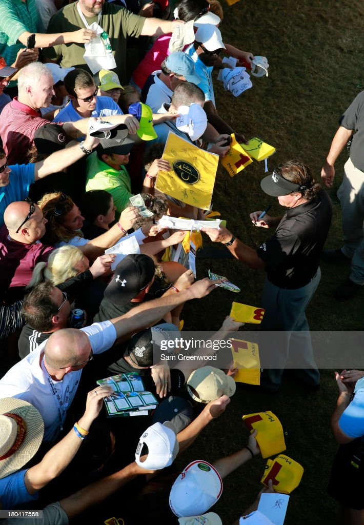 Phil Mickelson signs autographs after the First Round of the BMW Championship at Conway Farms Golf Club on September 12, 2013 in Lake Forest, Illinois.