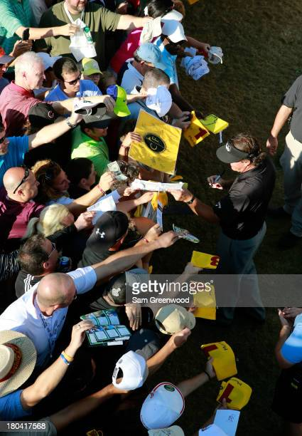 Phil Mickelson signs autographs after the First Round of the BMW Championship at Conway Farms Golf Club on September 12, 2013 in Lake Forest,...